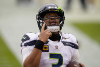 Seattle Seahawks quarterback Russell Wilson (3) points upwards before the start of the first half of an NFL football game against the Washington Football Team, Sunday, Dec. 20, 2020, in Landover, Md. (AP Photo/Andrew Harnik)