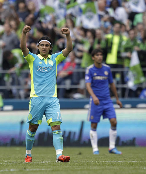 Seattle Sounders' Fredy Montero, left, celebrates scoring his second goal against Chelsea in the first half of an exhibition soccer match, Wednesday, July 18, 2012, in Seattle. (AP Photo/Ted S. Warren)