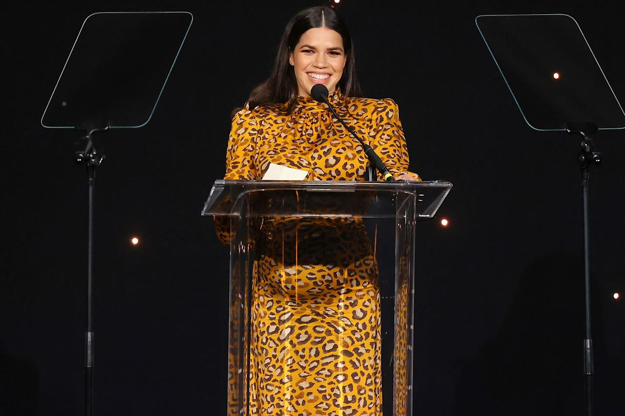 America Ferrera smiles brightly while accepting an award onstage during Friday's 23rd Annual NHMC Impact Awards Gala in Beverly Hills.