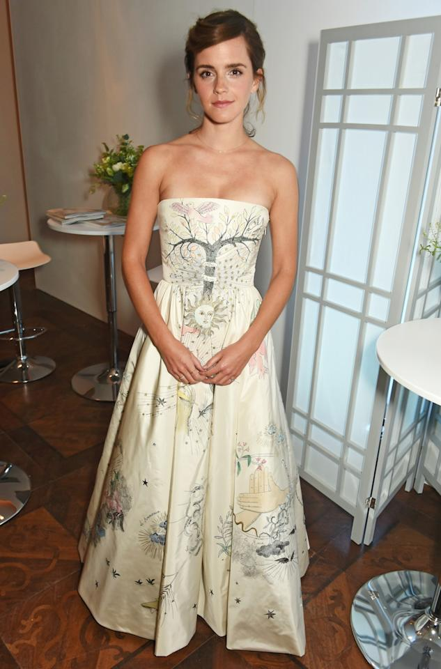 <p>Emma may have skipped the red carpet but her beautiful horoscope Dior gown did not go unnoticed. <i>[Photo: Getty]</i> </p>