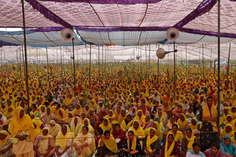Women farmers attend a protest against farm laws on the occasion of International Women's Day at Bahadurgar