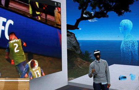 "Taj Reid, Senior Designer at Microsoft wears a HoloLens VR headset at Microsoft's Windows 10 ""Creators Update"" live event in the Manhattan borough of New York City, October 26, 2016. REUTERS/Lucas Jackson"