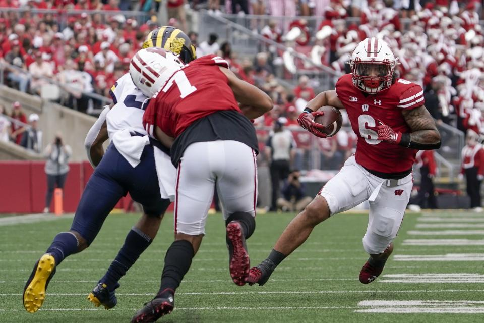 Wisconsin's Chez Mellusi runs during the first half of an NCAA college football game against Michigan Saturday, Oct. 2, 2021, in Madison, Wis. (AP Photo/Morry Gash)