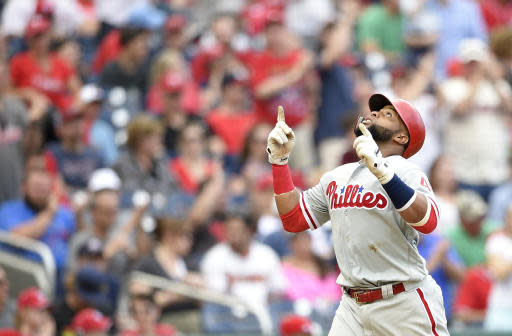 Philadelphia Phillies' Carlos Santana celebrates his home run during the eighth inning of a baseball game against the Washington Nationals, Saturday, June 23, 2018, in Washington. The Phillies won 5-3. (AP Photo/Nick Wass)