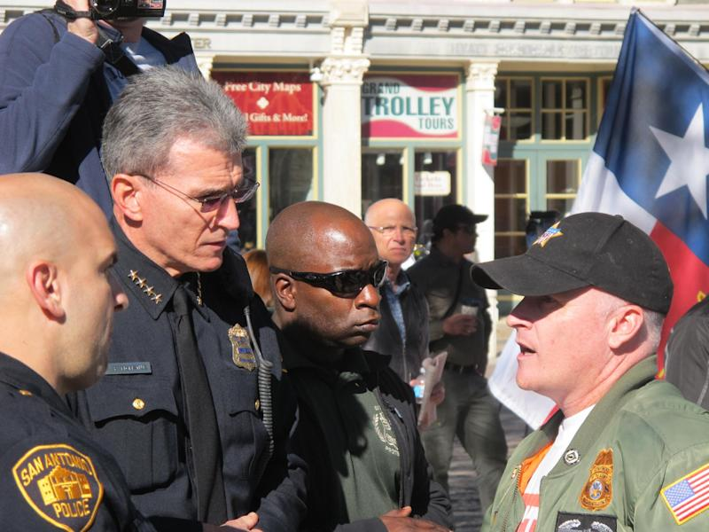 "San Antonio Police Chief William McManus, left, speaks with C.J. Grisham, right, president of Open Carry Texas, one of the organizers of the ""Come and Get It San Antonio!"" rally at the Alamo in San Antonio, Texas on Oct. 19, 2013. Gun rights advocates demonstrated in support of a Texas law that permits the open carry of long arms, such as rifles and shotguns. (AP Photo/Christopher Sherman)"
