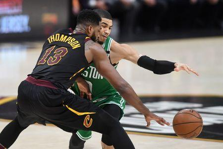 May 21, 2018; Cleveland, OH, USA; Cleveland Cavaliers center Tristan Thompson (13) and Boston Celtics forward Jayson Tatum (0) reach for the ball during the second quarter in game four of the Eastern conference finals of the 2018 NBA Playoffs at Quicken Loans Arena. Mandatory Credit: Ken Blaze-USA TODAY Sports