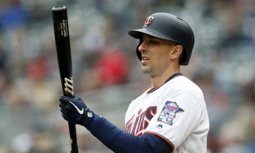 Minnesota Twins' Jason Castro waits to bat in the eighth inning of a baseball game against the Houston Astros, Thursday, May 2, 2019, in Minneapolis. Castro had four RBIs including a home run in the Twins 8-2 win. (AP Photo/Jim Mone)
