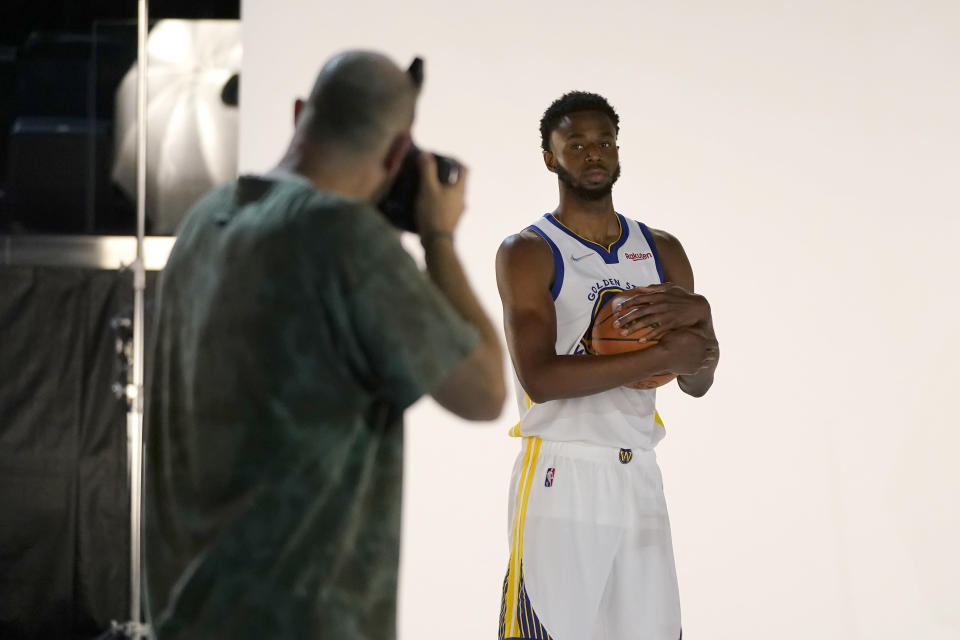 Golden State Warriors forward Andrew Wiggins, right, poses for photographer Noah Graham during the NBA basketball team's media day in San Francisco, Monday, Sept. 27, 2021. (AP Photo/Jeff Chiu)