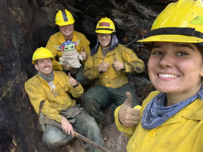 From left: Lucas Galloway, Jaebyn Drake, Rhett Schieder and Audrey Wilcox pose for a selfie with Baby Yoda on Sept. 20, 2020, while fighting the Holiday Farm Fire in Blue River, Oregon. (Courtesy of Audrey Wilcox via AP) (Audrey Wilcox / AP)