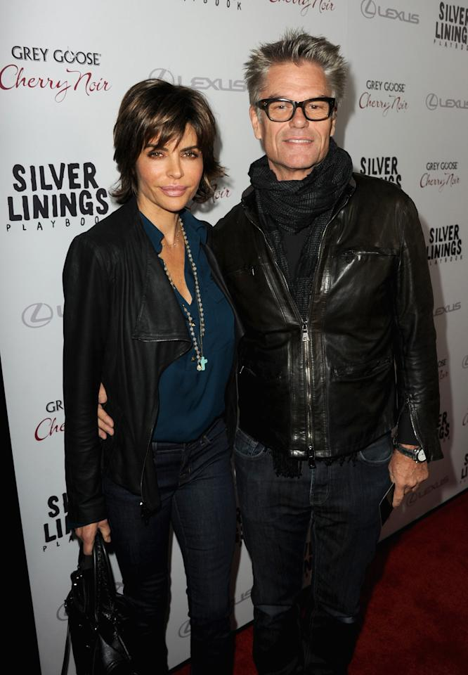 """BEVERLY HILLS, CA - NOVEMBER 19:  Actress Lisa Rinna and actor Harry Hamlin attend a screening of The Weinstein Company's """"Silver Linings Playbook"""" at the Academy of Motion Picture Arts and Sciences on November 19, 2012 in Beverly Hills, California.  (Photo by Kevin Winter/Getty Images)"""