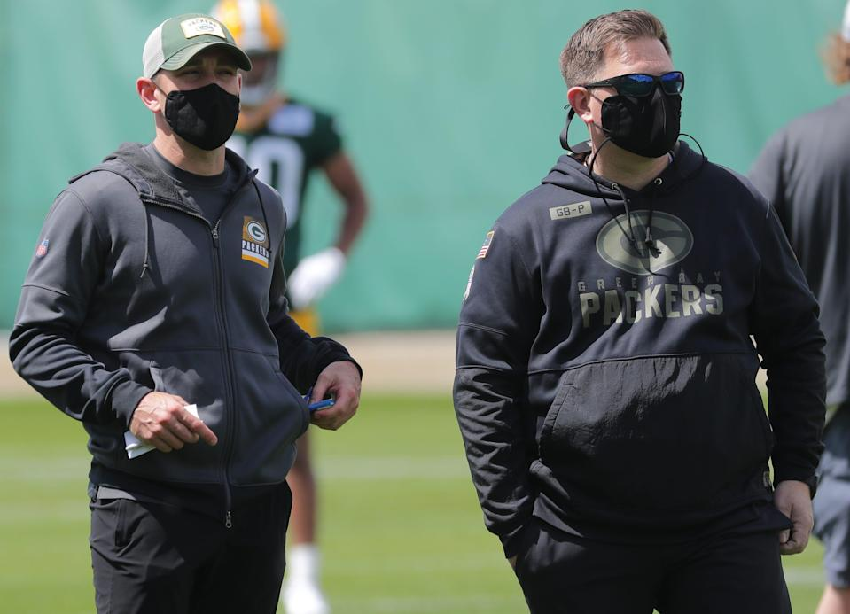 Green Bay Packers head coach Matt LaFleur and general manager Brian Gutekunst watch during the first day of rookie minicamp on Friday.