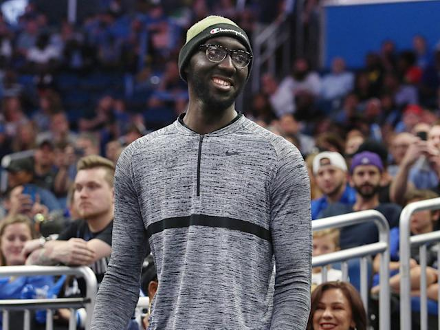 UCF center Tacko Fall watches during the Atlanta Hawks-Orlando Magic NBA game on April 5. (Getty)
