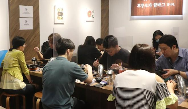 While restaurants were once again allowed to serve dine-in customers after 6pm, a number of social-distancing regulations remain in place, including a limit of two per table. Photo: K. Y. Cheng