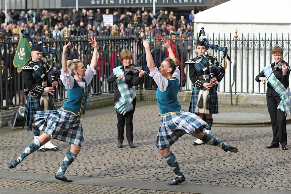 Highland dancers and musicians perform outside Westminster Abbey in London ahead of the the Commonwealth Service on Commonwealth Day. The service is the Duke and Duchess of Sussex's final official engagement before they quit royal life.