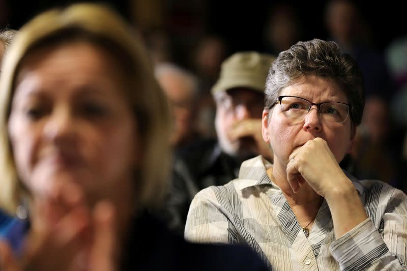 FILE PHOTO: Voters listen as U.S. Democratic presidential candidate Sen. Elizabeth Warren holds a town hall event in West Des Moines