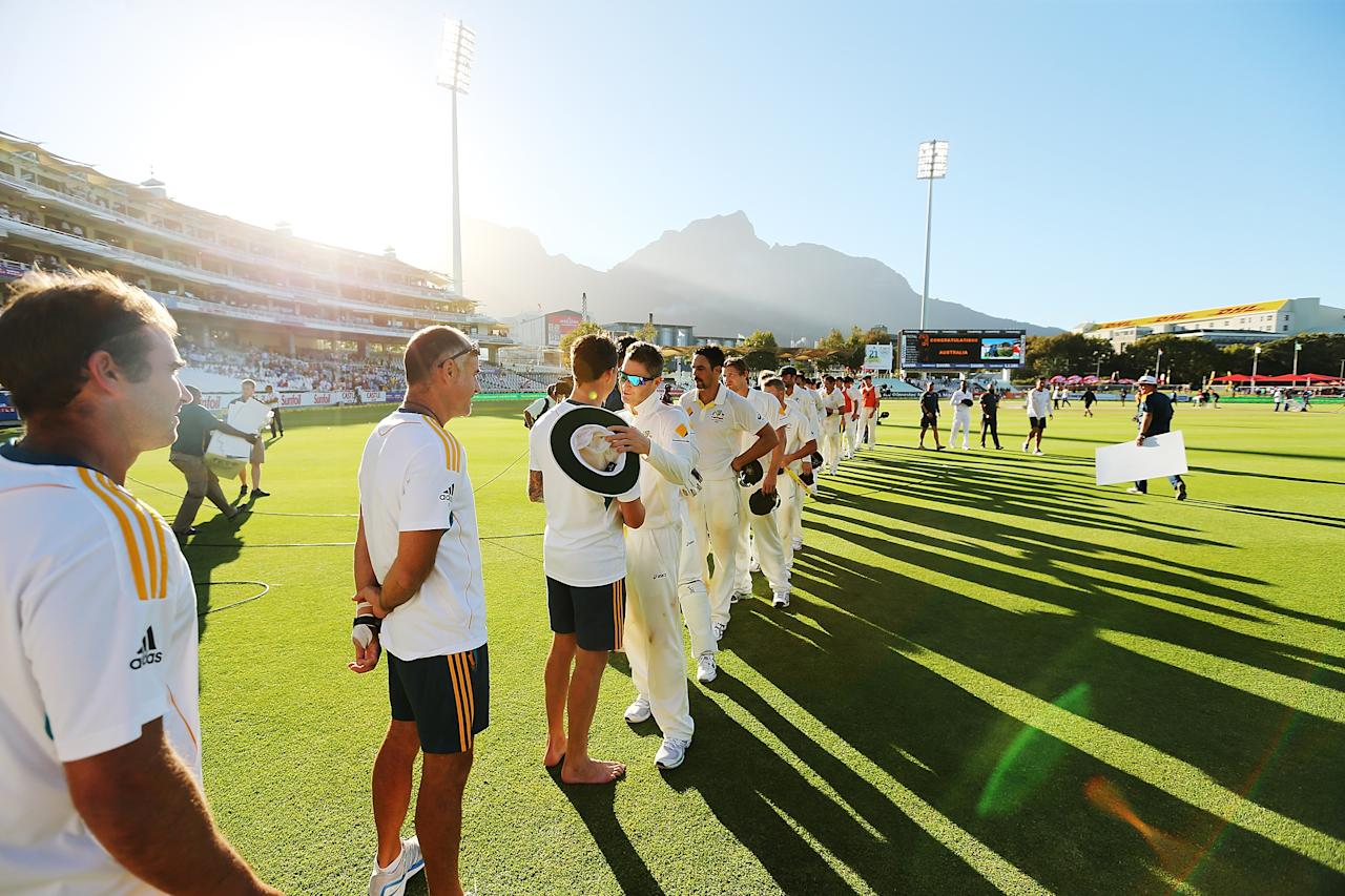 CAPE TOWN, SOUTH AFRICA - MARCH 05: Teams line up to shake hands after the match during day 5 of the third test match between South Africa and Australia at Sahara Park Newlands on March 5, 2014 in Cape Town, South Africa.  (Photo by Morne de Klerk/Getty Images)