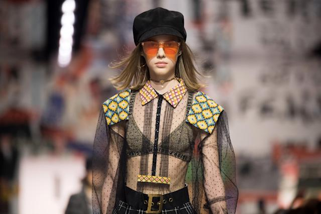 Newsboy caps and orange-tinted sunglasses at Dior Fall 2018. (Photo: Getty Images)