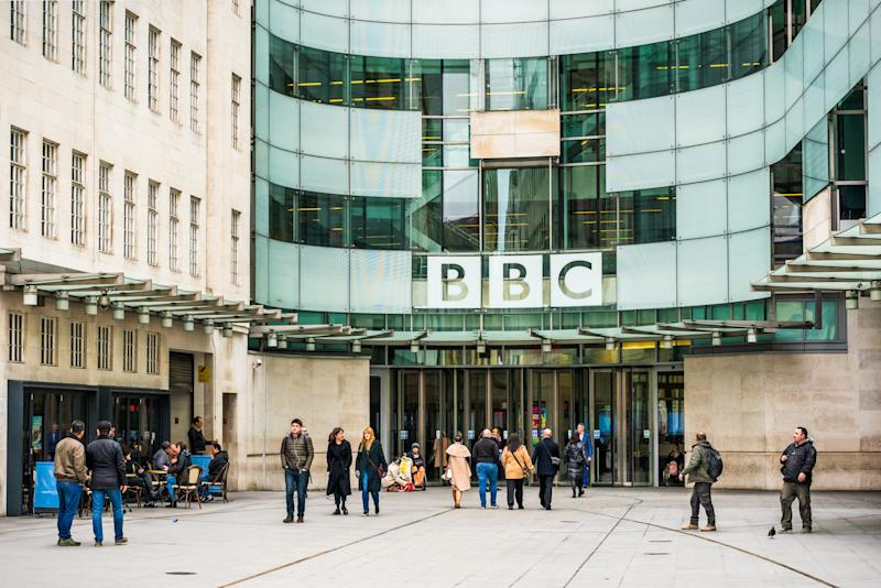 London, UK - People outside the main entrance to the BBC's Broadcasting House building in central London.