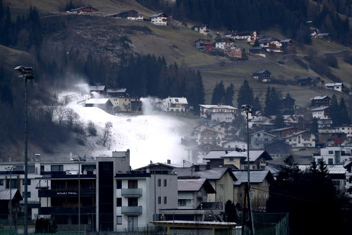 Snow maker spray snow in See near Ischgl, Austria, Thursday, Nov. 26, 2020. The Austrian government imposed a second lockdown to slow down the ongoing pandemic of the COVID-19 disease caused by the SARS-CoV-2 coronavirus, from Nov. 17, 2020 until at least Dec. 6, 2020. (AP Photo/Matthias Schrader)