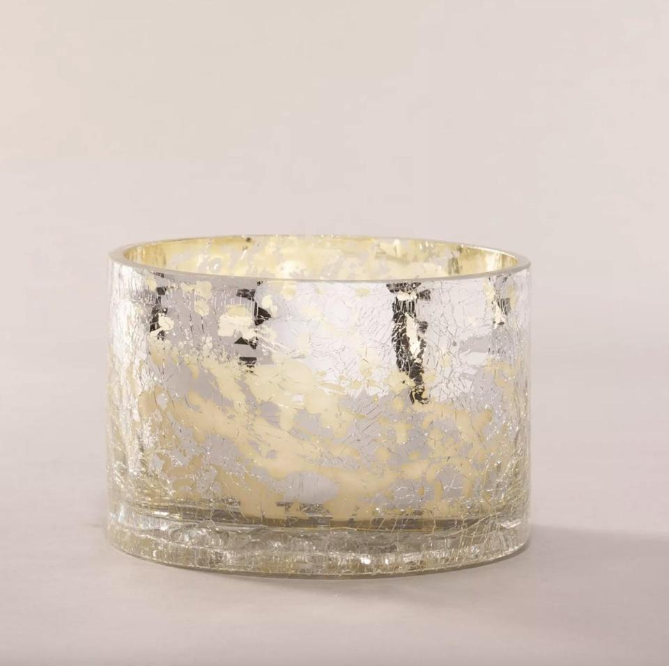 <p>This gorgeous <span>Cashmere Plum Glass Jar 3-Wick Candle</span> ($15) would add the chicest touch to a coffee table, mantel, or bedside table.</p>