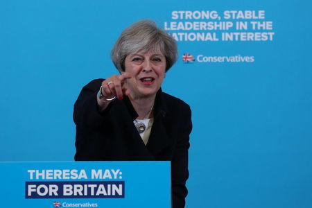 Targeting core Labour voters, UK's May promises more workers' rights
