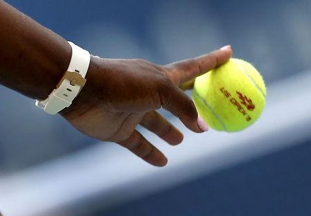 Serena Williams of the U.S. bounces a tennis ball as she prepares to serve to Kiki Bertens of the Netherlands at the U.S. Open Championships tennis tournament in New York, September 2, 2015. REUTERS/Mike Segar