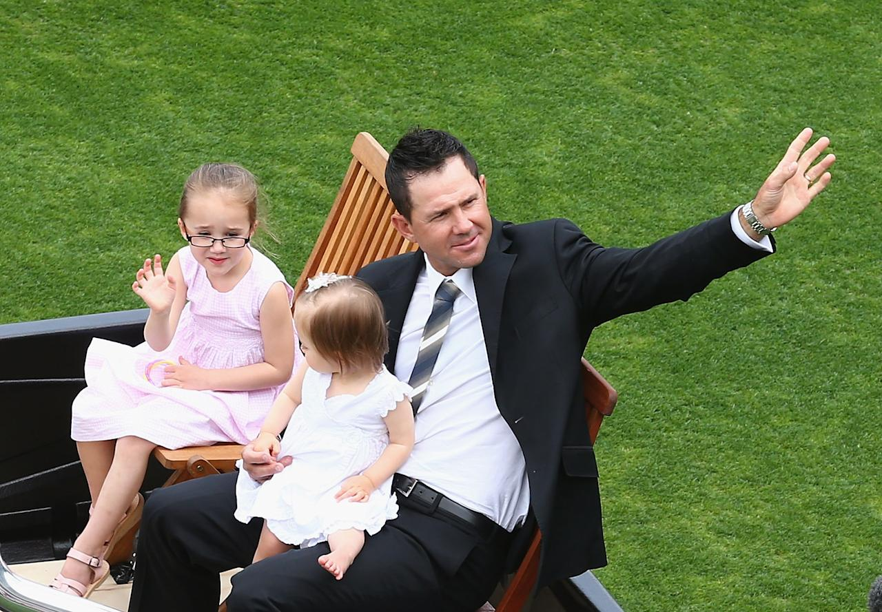 HOBART, AUSTRALIA - DECEMBER 14: Former Australian cricketer Rick Ponting waves to the crowd on a farewell lap with his daughters Emmy and Matisse during day one of the First Test match between Australia and Sri Lanka at Blundstone Arena on December 14, 2012 in Hobart, Australia.  (Photo by Robert Cianflone/Getty Images)