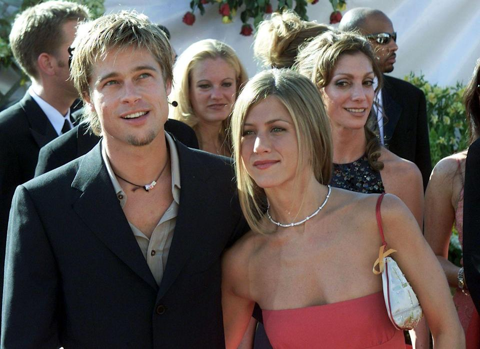 """<p>After being set up <a href=""""https://www.marieclaire.com/celebrity/g18655293/brad-pitt-jennifer-aniston-relationship-timeline/"""" rel=""""nofollow noopener"""" target=""""_blank"""" data-ylk=""""slk:by their agents"""" class=""""link rapid-noclick-resp"""">by their agents</a>, Aniston and dreamboat movie star Brad Pitt, began dating. They made their debut as a couple on the red carpet in 1999, and a year later the two were married in Malibu.</p>"""