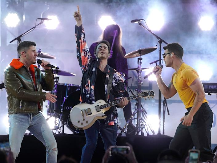 The Jonas Brothers performing on stage at the 2021 Billboard Music Awards.