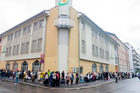 People gather outside the Islamic Cultural Centre to show solidarity with the Muslim community after Saturday's shooting at a mosque, in Oslo