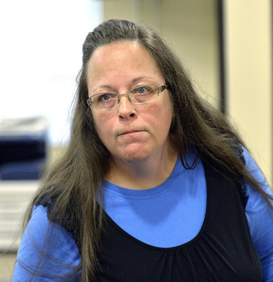 FILE - In this Sept. 1, 2015, file photo, Rowan County Clerk Kim Davis listens to a customer at the Rowan County Courthouse in Morehead, Ky. Elwood Caudill says he plans to run for county clerk against Davis, who caused an uproar in 2015 when she refused to issue marriage licenses because of her opposition to same-sex marriage. Caudill ran against Davis in 2014 in the Democratic primary, but lost by 23 votes. In 2018, Caudill will run as a Democrat while Davis has switched parties to become a Republican. (AP Photo/Timothy D. Easley, File)