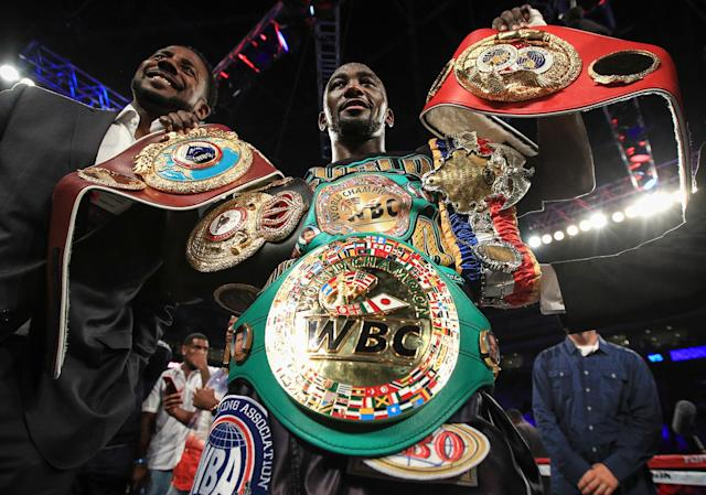 Terence Crawford displays his world title belts after he unified the super lightweight division by knocking out Julius Indongo in August. (Mikey Williams/Top Rank)
