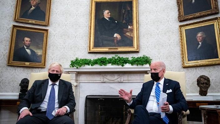 US President Joe Biden meets with British Prime Minister Boris Johnson in the Oval Office of the White House