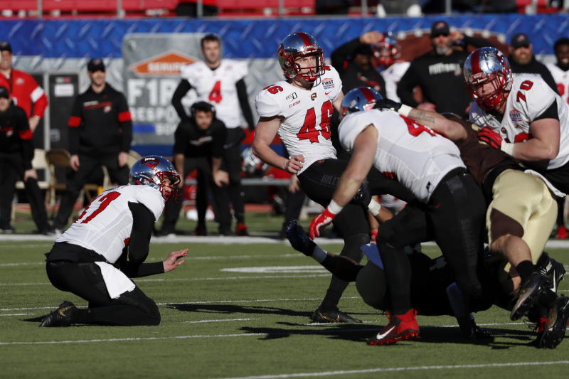 Western Kentucky place kicker Cory Munson (46) and holder John Haggerty (47) watch the game winning kick go through the uprights in the final seconds of the NCAA First Responder Bowl college football game against Western Michigan in Dallas, Monday, Dec. 30, 2019. Western Kentucky won the game 23-20. (AP Photo/Roger Steinman)