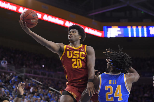 Southern California guard Ethan Anderson, left, shoots as UCLA forward Jalen Hill defends during the first half of an NCAA college basketball game Saturday, Jan. 11, 2020, in Los Angeles. (AP Photo/Mark J. Terrill)