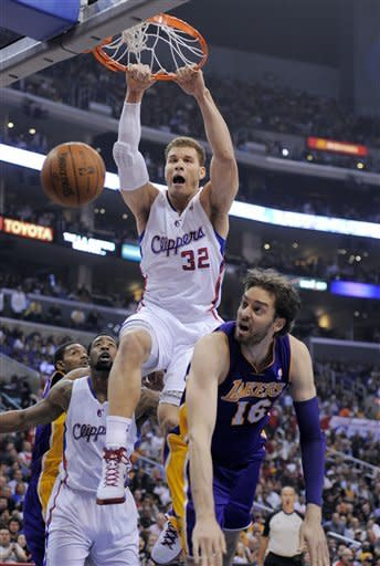 Los Angeles Clippers forward Blake Griffin dunks over Los Angeles Lakers forward Pau Gasol, of Spain, during the first half of an NBA basketball game, Wednesday, April 4, 2012, in Los Angeles. (AP Photo/Mark J. Terrill)