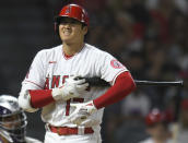 Los Angeles Angels' Shohei Ohtani reacts to a pitch in the fourth inning of the team's baseball game against the Colorado Rockies Wednesday, July 28, 2021, in Anaheim, Calif. (AP Photo/John McCoy)
