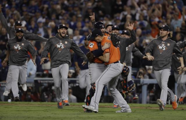 Andrew Watt maxed out his credit cards to go to every World Series game, and was rewarded with a Game 7 win. (AP Photo)