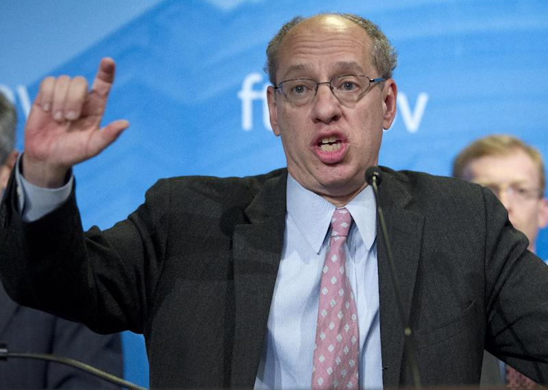 Federal Trade Commission (FTC) Chairman Jon Leibowitz gestures as he speaks during a news conference at FTC in Washington, Thursday, Jan. 3,  2013, to announce that Google is agreeing to license certain patents to mobile phone rivals and stop a practice of including snippets from other websites in its search results as part of a settlement to end a 19-month investigation in the search leader's business practices. ( AP Photo/Jose Luis Magana