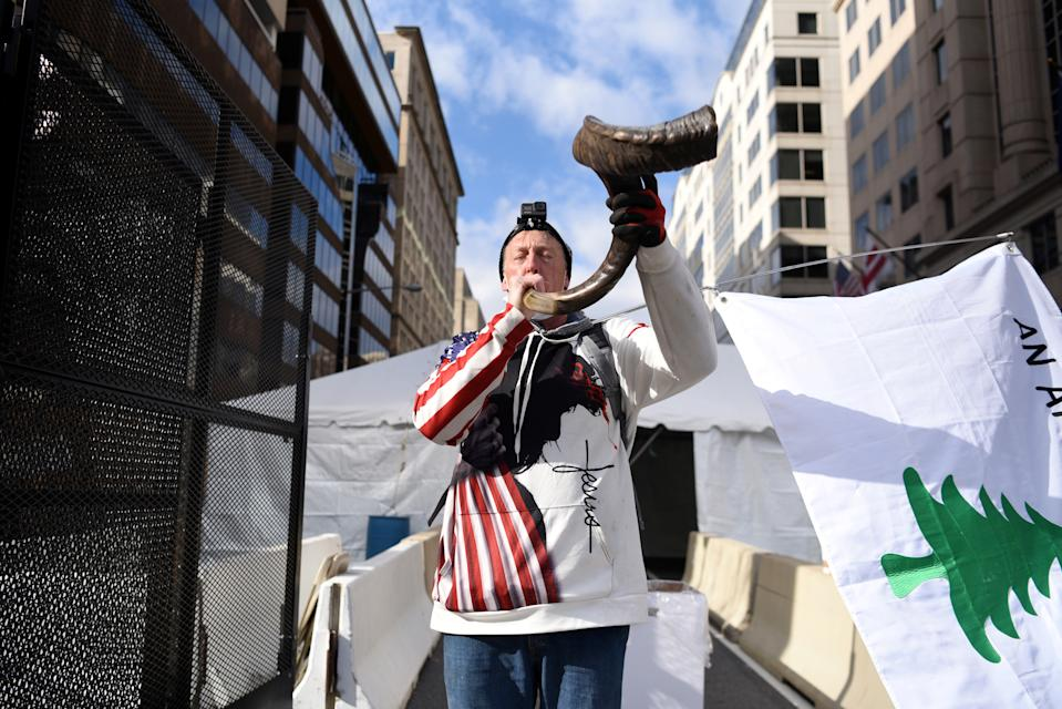 David Wood, of Reno, plays a shofar during a prayer walk ahead of U.S. President-elect Joe Biden's Presidential Inauguration in front of the White House, in Washington, U.S., January 19, 2021.  (Callaghan O'Hare/Reuters)