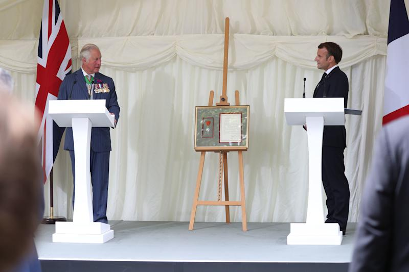 LONDON, ENGLAND - JUNE 18: French president Emmanuel Macron and Prince Charles, Prince of Wales during a ceremony at Carlton Gardens on June 18, 2020 in London, England. L'Appel du 18 Juin (The Appeal of 18 June) was the speech made by Charles de Gaulle to the French in 1940 and broadcast in London by the BBC. It called for the Free French Forces to fight against German occupation. The appeal is often considered to be the origin of the French Resistance in World War II. President Macron is the first foreign dignitary to visit the UK since the coronavirus lockdown began. (Photo by Jonathan Brady - WPA Pool/Getty Images)
