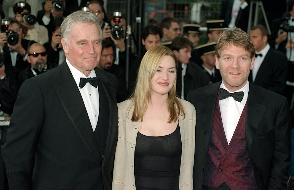 Kate Winslet arrives with Charlton Heston and Kenneth Branagh for the 50th Annual Cannes Film Festival Gala at the Palais des Festivals in Cannes, France (Photo by Neil Munns - PA Images/PA Images via Getty Images)