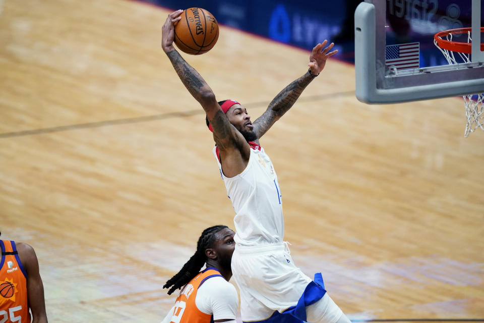 New Orleans Pelicans forward Brandon Ingram goes to the basket during the first half of the team's NBA basketball game against the Phoenix Suns in New Orleans, Friday, Feb. 19, 2021. (AP Photo/Gerald Herbert)