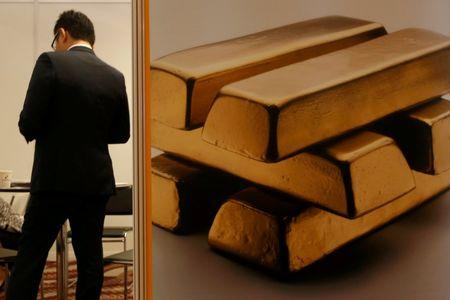 Gold slides amid Fed leadership speculation