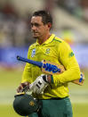 South Africa's captain Quinton de Kock leaves the field after being dismissed by England's bowler Mark Wood for 65 runs during the 2nd T20 cricket match between South Africa and England at Kingsmead stadium in Durban, South Africa, Friday, Feb. 14, 2020. (AP Photo/Themba Hadebe)