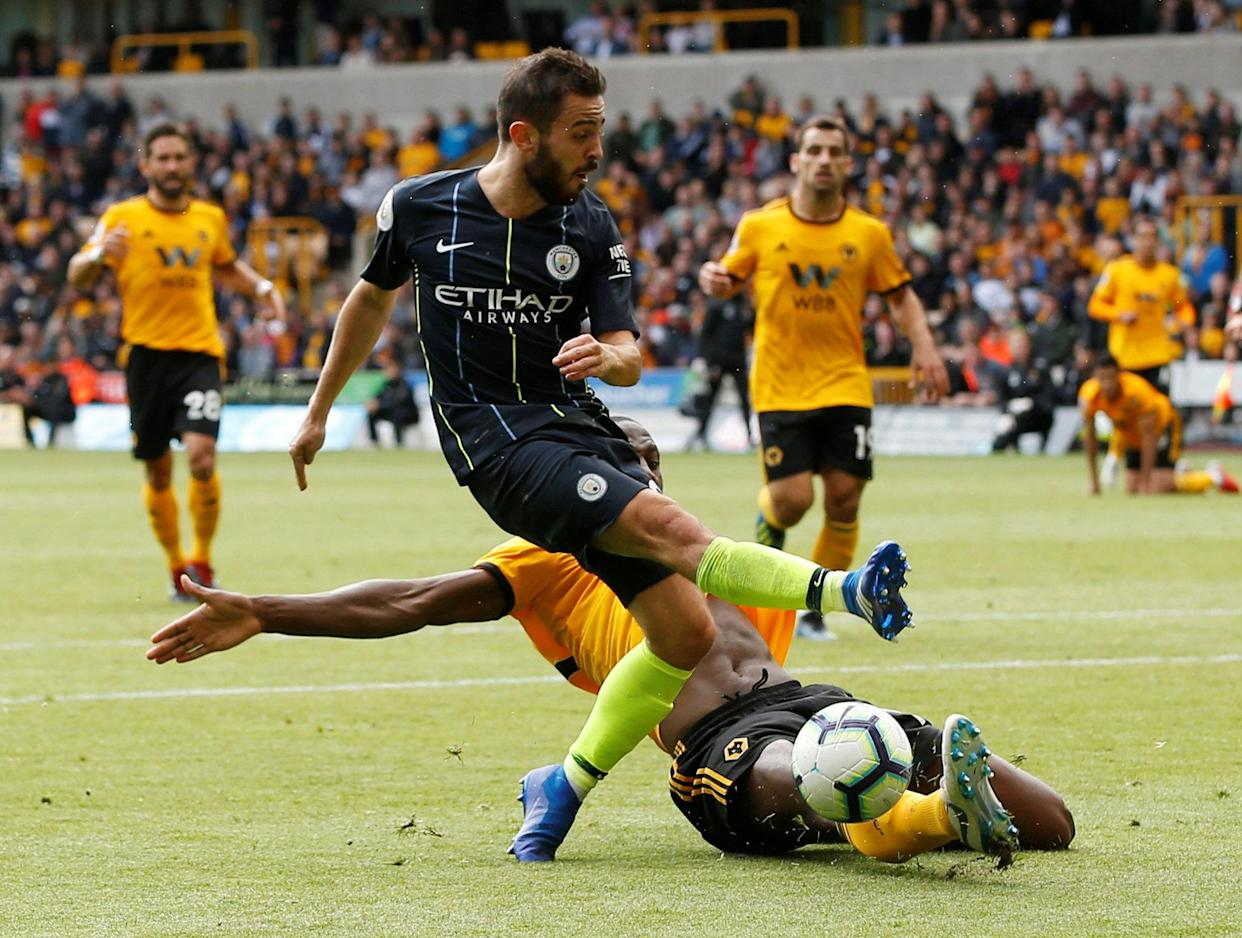 City's Bernardo Silva clashes with Willy Boly in an entertaining Premier League match on Saturday