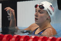 Katie Ledecky of the United States rests after her heat the women's 200-meter freestyle at the 2020 Summer Olympics, Monday, July 26, 2021, in Tokyo, Japan. (AP Photo/Matthias Schrader)