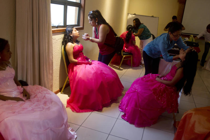 "Nicaraguan girls suffering from cancer prepare for a ""quinceanera"" party in Managua, Nicaragua, Saturday Sept. 21, 2013. For each of the past five years, Nicaragua's Association of Mothers and Fathers of Children with Cancer and Leukemia has put on a ""quinceanera"" party for girls from poor, rural families, teens who have the added burden of dealing with cancer. This year's party feted 37 girls between ages 14 and 16 on Saturday night at a hotel in Nicaragua's capital.(AP Photo/Esteban Felix)"