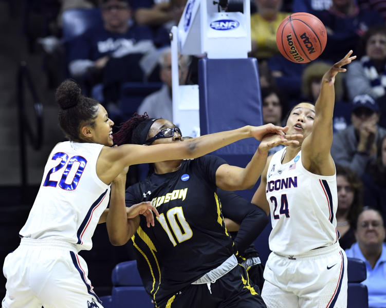 Connecticut's Olivia Nelson-Ododa (20) and Napheesa Collier (24) defend against Towson's Janeen Camp (10) during a first round women's college basketball game in the NCAA Tournament, Friday, March 22, 2019, in Storrs, Conn. (AP Photo/Stephen Dunn)