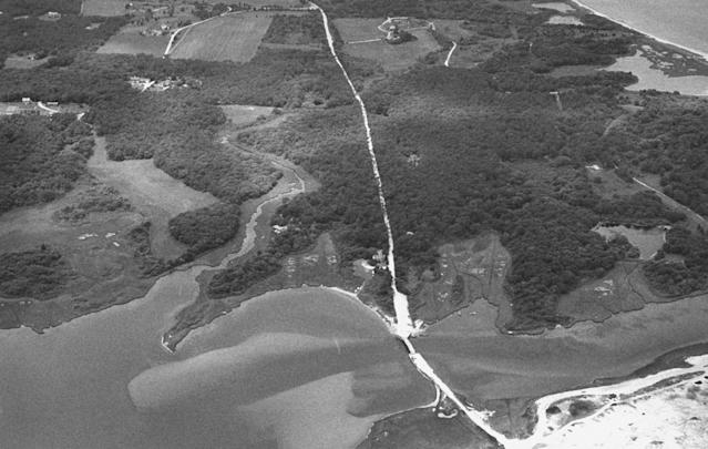 <p>Aerial view of the Dike Bridge and surrounding land. Mary Jo Kopechne drowned in the car that Sen. Ted Kennedy drove over the side of this bridge in July, 1969. (Photo: Steve Liss/The LIFE Images Collection/Getty Images) </p>